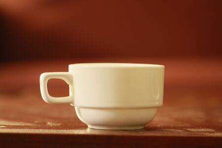 white color empty tea cup on a brown wooden table 스톡 콘텐츠
