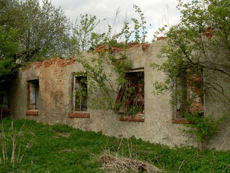 The wall and windows in ruined  old house. Stock Photo - 4710633