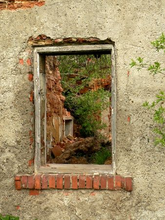 The wall and window in ruined  old house. photo
