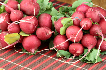 Bunch of fresh radish on wooden table. photo