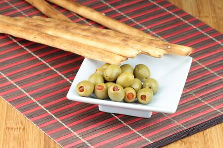 grissini: Italian Grissini bread stick and olives with red pepper.