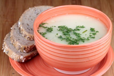 Mushrooms soup on bowl with cereal bread. photo