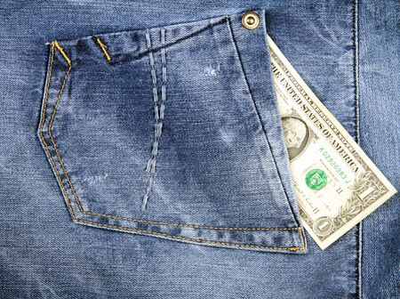 One Dollar in pocket of blue jeans. photo