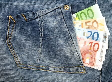 cash back: Euro banknotes in pocket of blue jeans. Stock Photo