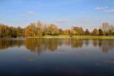 Nature in autumn with reflection in lake. Stock Photo - 8183474
