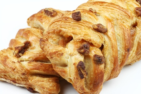 Close-up of two pastries filled by honey syrup and sprinkled by pecan nuts. Stock Photo - 10075213