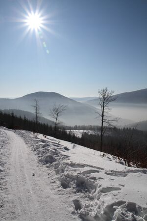 Winter path in mountain with lot of snow and sunny day. photo