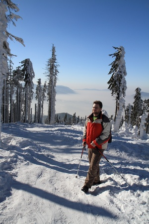 Hiker on the snow  - beautiful winter day in mountain. photo