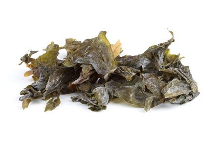 Dried irish Sugar Kelp seaweed isolated over white  Stock Photo