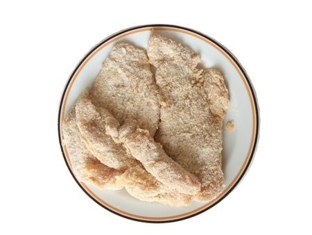 Rolled raw chicken in breadcrumbs on plate and isolated on white Stock Photo - 13036031