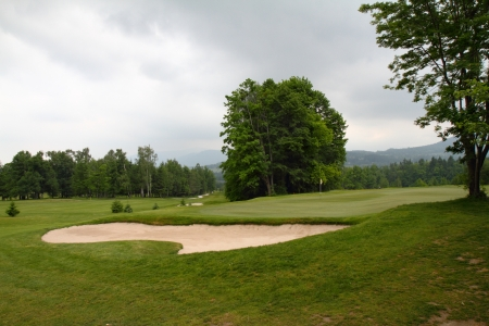 Storm clouds over the mountains and golf resort  photo