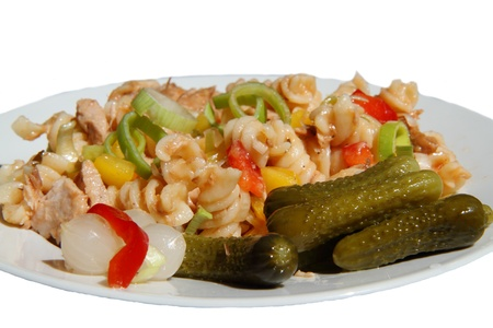 Pasta salad with tuna meat, tomato, onion, pepper and gherkin   photo