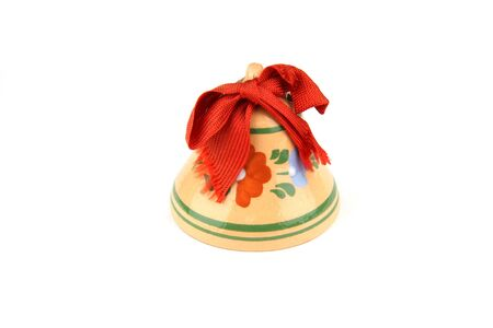 Christmas Bell from ceramic with red ribbon on white background  photo