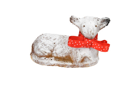 Easter lamb with red ribbon and powdered by sugar on white background. photo