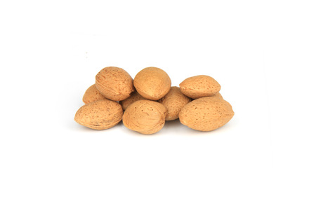 Heap of almond nuts on white background. photo