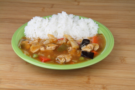rice plate: Rice with chicken and vegetable on green plate. Stock Photo