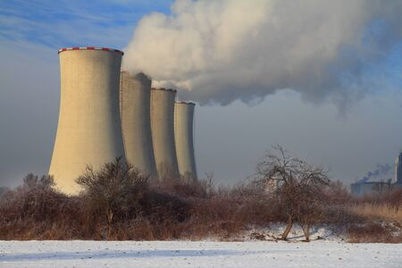The steam from the cooling towers of power plant. Stock Photo