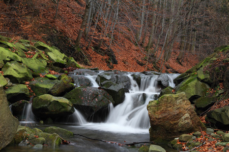 Small waterfall on a creek in the woods. Stock Photo