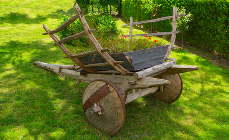 Old horse drawn wagon in country setting Stock Photo