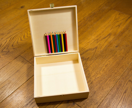 writing implements: Wooden color pencils holder Stock Photo