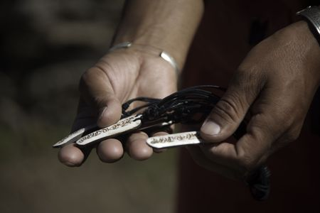 sherpa: Sherpa Man Offers Buddhist Prayer Necklaces For Sale