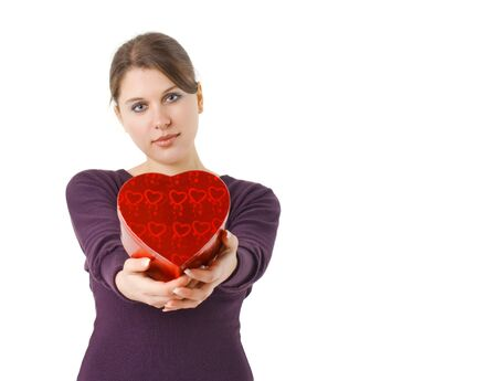 woman holding heart shaped gift box for Valentines day Stock Photo - 4089152