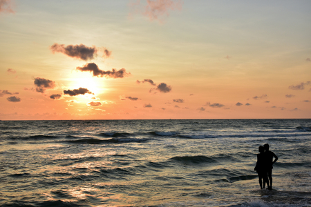 beatification: Looking  sunrise in the sea at dawn happily Stock Photo