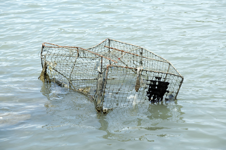 Fishing gear used to catch fish old waste dumped into the sea. Stock Photo
