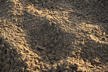 caused: Sand patterns caused by the footprints of bird Stock Photo
