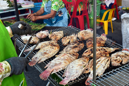 hot asian: Cooking the Red tilapia grilled , You need to put spices on the fish and grill until golden on both sides Фото со стока