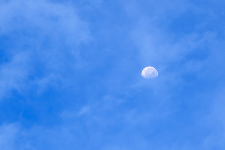 The moon is visible in the sky even in the morning Stock Photo