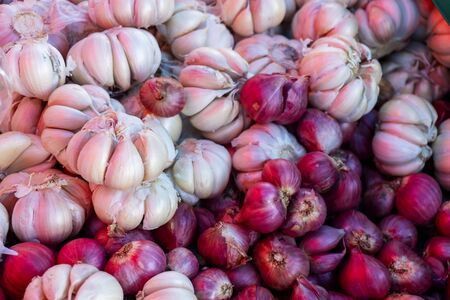 Garlic and red onion are sold in popular markets to cook curry and stir in Thailand, healthy and body