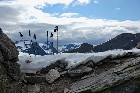 trekking pole in the snow at the top of the norwegian mountains Stock Photo