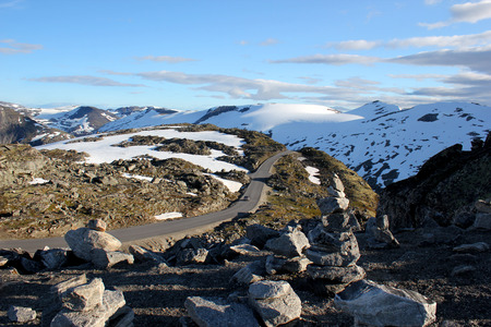 road in a snowy mountain area of norway Stock Photo