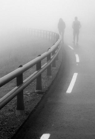 girl and guy on the road fog