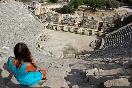 girl looks into the arena of the amphitheater on top of the world Stock Photo