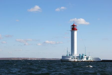 seascape blue sky white lighthouse beach Stock Photo