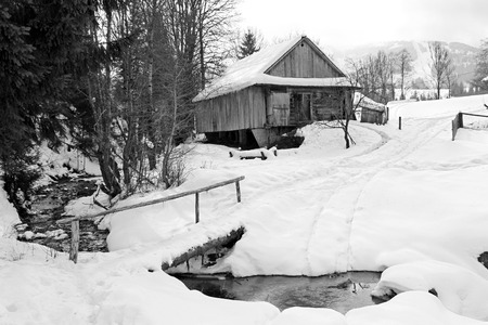 winter landscape house near the road and the bridge over the river