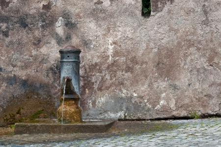 Roman drinking fountain photo