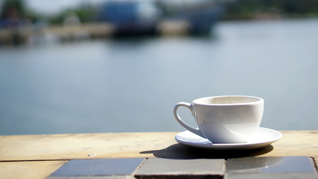 Cappuccino Coffee. A cup of latte, cappuccino or espresso coffee put on a table. Stock Photo