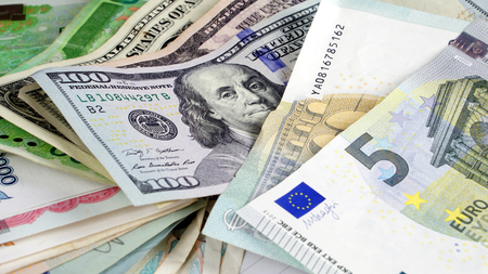 US dollars, Korean Won, Euro bills and some money bills and banknotes. Currency foreign exchange. Business and Financial or money management for investments. Stock Photo