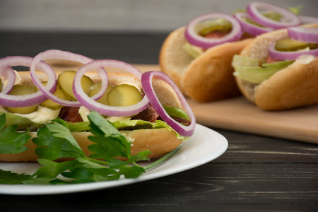 Hot dog with vegetables, ketchup and mayonnaise Stock Photo