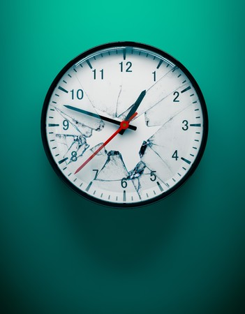 3D redner of a shattered wall clock on aqua blue