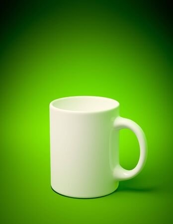 3D render of a white mug on green background Stock Photo