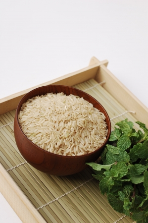 Red brown rice in wooden bowl