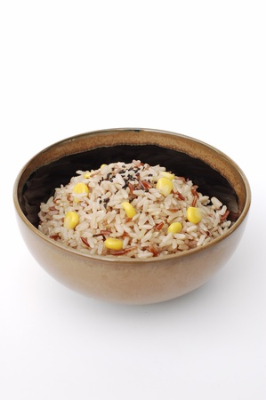 cooked mixed rice in ceramic bowl with corn and black sesame on white background Stock Photo