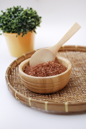 Red rice in wooden bowl Stock Photo