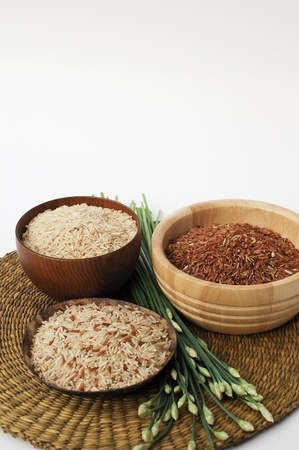 3 bowls of raw brown, red, and mixed rice Stock Photo