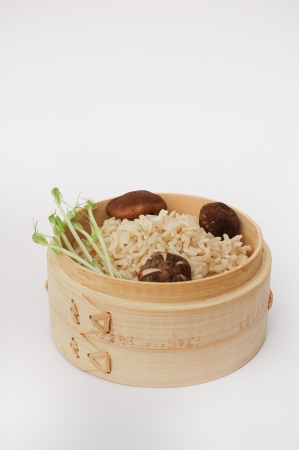 bowl of raw rice with vegetable and mushroom