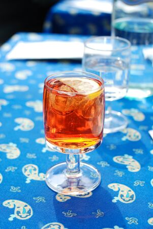 spritz: A glass of Spritz Aperol aperitif on blue table cloth, Italy Stock Photo